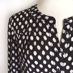 "Banana Republic Bold Dot Blouse Classically chic black and white dot patterned blouse from BR. Banded collar with buttoned placket. Straight hem. Looks fabulous tucked into a pencil skirt or worn loose over skinny jeans! 100% polyester. Machine wash. Size XS. Bust: 18"".  Length: 25"".  Shoulder to shoulder: 15"". EUC. Thanks for looking! Banana Republic Tops Button Down Shirts"