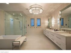 225 Conners Ave, Naples, FL 34108 | Gorgeous white contemporary bathroom in Connors Vanderbilt Beach - Naples Coastal Contemporary Homes for Sale