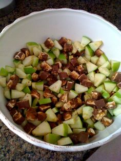 Apple Snickers Salad - All you need is: 6 green apples, 6 snicker bars,  1 pkg butterscotch pudding mix  1 container Cool Whip