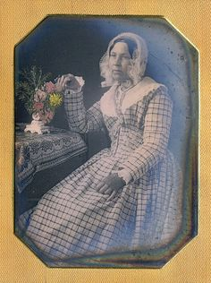 Dennis A. Waters Fine Daguerreotypes \ The middle-aged woman sat comfortably next to a table supporting a small vase filled to overflowing with expertly tinted flowers and greenery. In fact, I can't recall ever seeing any better pigment placement circa Louis Daguerre, Antique Photos, Vintage Photographs, Vintage Photos, Victorian Era, Victorian Fashion, Old Pictures, Old Photos, Ladies Day Dresses