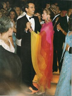 "Princess Grace dancing with Dr Christian Barnard at the Monaco Red Cross Ball 1968. She is wearing her Marc Bohan design for Dior of the :""La Bayadere ""gown."