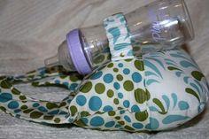 Baby bottle holder by Bugaboobliss on Etsy- Life Saver!