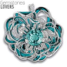 Chanel Camellia brooch with Paraiba tourmaline inspired by a single rare stone: a 38-carat, blue-green Paraiba tourmaline, which in the brooch is encircled by diamonds and sea-blue. @chanelofficial #Chanelofficial #forever #Paraiba #tourmalines #tourmaline #chanel