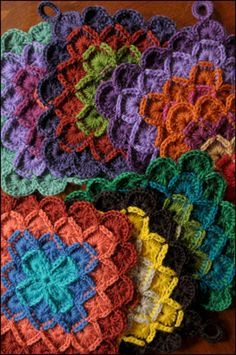 crochet pot holders by knitterlythings on ravelry.  LOVE the color combos!