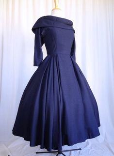 1950s Fabulous Suzy Perrette New Look navy blue dress with off the shoulder shawl collar, circle skirt and wasp waist