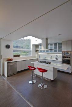 neat idea for tall window above sink - Lucernas House / 01 Arq