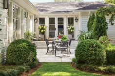 Now It's a Permanent Outdoor Room - Before-and-After Porch Makeovers That You Need to See to Believe - Southernliving. French doors were added to allow people to move more easily between the indoors and outdoors. Replacing the wood deck with pavers give the space a feeling of permanence.