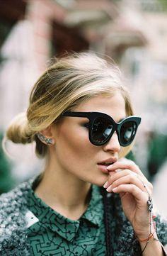 oversized cat-eye sunglasses, low bun, statement earrings & graphic print shirt #style #fashion #hair