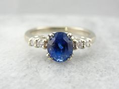 Gleaming Blue Sapphire and Diamond Engagement Ring by MSJewelers