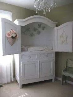 Changing table out of repurposed entertainment center.
