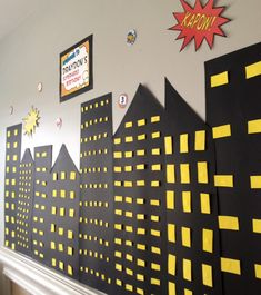 Superhero birthday party. Would be easy to do on a wall with black poster board.