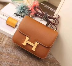 crafted from box leather flap over design Fully lined in leather with 2 open pockets. Hermes embossed on the hardware Genuine imported box leather. Hermes Constance Bag, Popular Purses, Small Handbags, Hardware, Pockets, Box, Leather, Design, Snare Drum