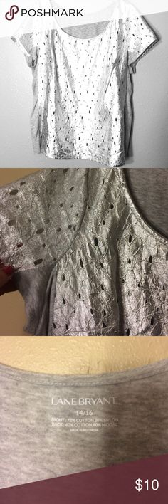 Lane Bryant Metallic Blouse This shirt is prefect for the holidays with a foil/metallic front and cotton back. This top fits loose in the middle and tailored at the top. Tops Tees - Short Sleeve