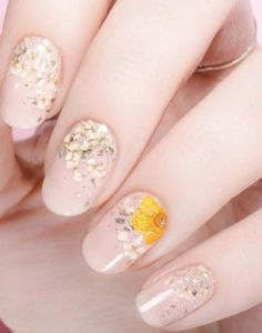 This nail art is seriously going to be every where this spring. We're going crazy for this floral manicure trend...its all the nail inspo you need for your next salon visit..
