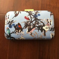 J.crew clutch in bird print Super cute - I adore the print!  From J.crew factory.  Used once - there is a small red circular mark on one side - see pic 3, lowered price accordingly.  No trade and no Paypal, thanks! J. Crew Bags Clutches & Wristlets