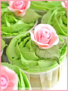 These cute pink & green cupcakes look like they are baked in a ketchup cup.