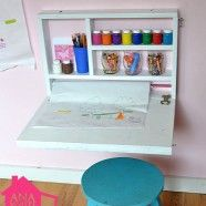 Flip down art desk... I would make it look more shabby chic by adding wallpaper behind the shelves and pretty trim on the edges