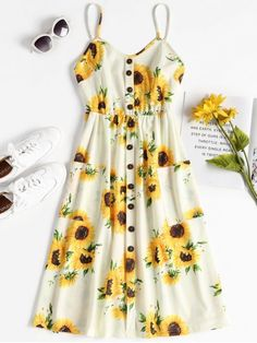 Button Sunflower Print Midi Dress. Your go-to dress for summer events. This moderate midi dress is suspended by slender shoulder straps and embellished with a row of contrasting buttons down the center front. Its large, opaque patch pockets add extra convenience to this bright sundress. #Zaful #Zaful4th #Dress