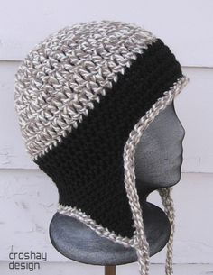 Ravelry: Flyflap Cap pattern by Laura Killoran. Laura Killoran designs wonderful crocheted hats. This design, the Flyflap Cap, is an aviator-style earflap hat pattern available for purchase on her website, Croshay Design.