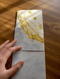 the work of Britta Gustafson, and her post about this project includes a lovely animation that shows the process of unfolding the flexagon to reveal all four faces of her book.