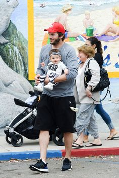Ashton Kutcher and Mila Kunis's seven month old daughter, Wyatt Isabelle, made her public debut yesterday in Los Angeles. - HarpersBAZAAR.com