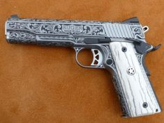 Ruger 1911...This is pretty! I see no reason not to have a functional gun that looks good, too.