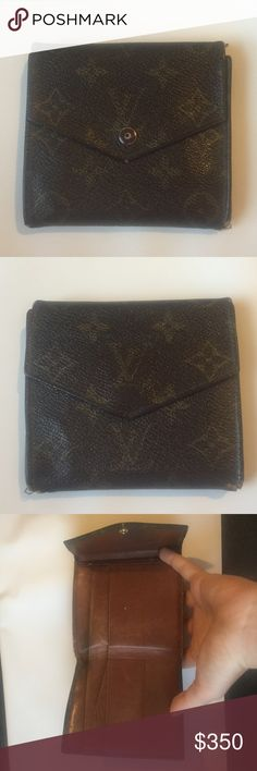 Louis Vuitton wallet In used condition. Authentic vintage wallet. Tons of compartments. Corners rubbed down. Tons of life left Louis Vuitton Bags Wallets