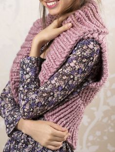 Free Knitting Pattern for Easy Quick Cozy Shrug - This easy shrug is a quick knit in super bulky yarn. The back is knit in one piece in garter stitch and then stitches are picked up for the border.