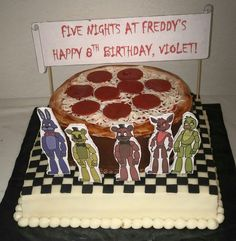 Five Night's At Freddy's themed cake. This was a gluten free carrot cake on the bottom and gluten free chocolate cake on top. www.VeronicasGoodies.com