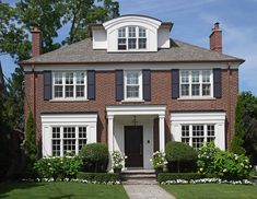 27 Dormer Window Ideas from New & Old Houses with Dormers (Photos) Example of a dormer window with an arched roof on the third floor of this stately brick home. Red Brick Exteriors, Colonial House Exteriors, Colonial Exterior, Red Brick Homes, Window Shutters Exterior, House Shutters, Black Shutters, Style At Home, English Cottage