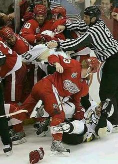 Detroit's Johan Franzen pounds Pittsburgh's Evgeni Malkin in third period fight that put three Penguins in the penalty box as the Red Wings beat the Penguins, 3-0, in the second game of the Stanley Cup Finals at Joe Louis Arena on Monday May 26, 2008.