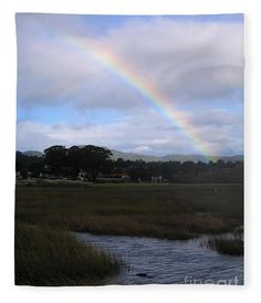 A rainbow arcs over the Carmel River lagoon in this soft fleece blanket. Image by James B. Toy. Blanket can be purchased through Pixels.com