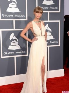 Taylor Swift (looking like a bitch like she really is) Grammy Awards 2013: Red Carpet Arrivals in J.Mendel