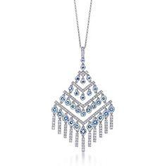 Chevron pendant with aquamarines and diamonds in platinum.