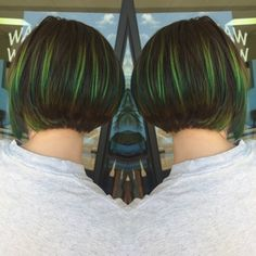 Toxic green and blue and her natural dark hair inverted bob