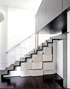 A MULTI LEVEL 425 SQUARE FOOT NEW YORK APARTMENT- The staircase leading up to level 3 doubles as storage with lacquer built in