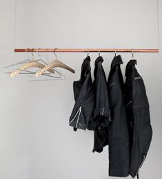 clothes rack: easy to made, just pull a cable through a nice looking rail