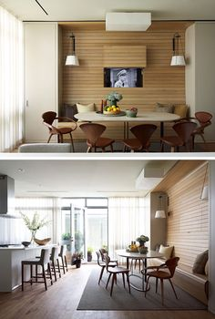 In this apartment, the television was placed behind a panel within the walnut wall, allowing it to be visible for when you want to watch tv, but at the same time, can be completely hidden away without the use of a bulky cabinet. Under Cabinet Tv, Hidden Tv Cabinet, Tv Wall Cabinets, Refinish Kitchen Cabinets, Tv In Kitchen, Kitchen Decor, Living Room Tv, Living Spaces, Tv Wall Panel