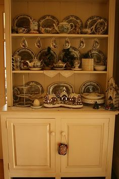 The Friendly Village in a china hutch decorated for Christmas