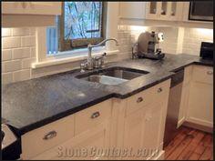 Soapstone countertops and subway tile backsplash