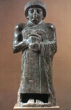 Votive Statue Of Gudea (2090 BCE). From Present- day Telloh, Iraq. Made of strong diorite, this statue shows the ruler Gudea during the Mesopotamian time period. It presents him as a strong, peaceful, pious ruler worthy of divine favor. The sculpture emphasizes the power of Gudea through the eyes, head, and muscles. KR