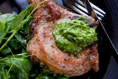 A pesto built on pea shoots, pine nuts and cilantro brightens this pork chop recipe The chops are seared, then roasted in an oven for 15 minutes, putting dinner on the table in less than an hour To serve, pair it with a light salad coated with lemon and olive oil, salt and pepper