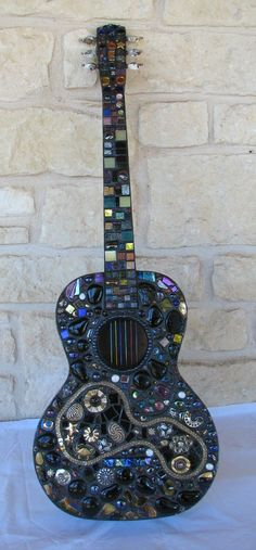 A creative way to use broken costume jewelry in a beautiful mosaic art piece.  Look for single earrings and rhinestone brooches at thrift shops and garage sales.  Combine with stained glass and tile.