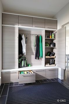 """Bench in mudroom has doors to hide ski boots. Like the """"closets"""" on the sides and the cabinets above"""
