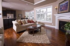 Nice colors and use of wood flooring w carpet or rug