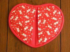I like Pauline's version of a heart potholder on Sew We Quilt.  It's nice that you don't have to bind the two back pieces, just the heart shape!