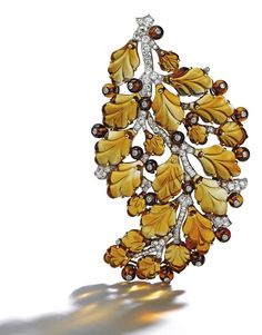 Gold, Platinum, Citrine and Diamond Brooch, Cartier  Of foliate design, set with numerous citrine beads and carved citrines in the form of leaves, accented by old European and single-cut diamonds weighing approximately 2.35 carats, signed Cartier; circa 1935.