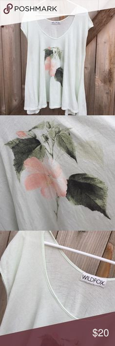 EUC Wildfox tee Excellent condition; super cute, flowy cotton/polyester tee. This is a medium but like most Wildfox, it would fit a range of sizes. So cute on!!! Wildfox Tops