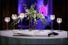 Austin Texas Event, Floral Pinspotting, Blue Room Wash, Uplighting, Drapery Lighting, Centerpiece lighting, Intelligent Lighting Design, ILD Lighting,