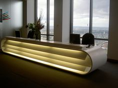 luxurious-contemporary-office-furniture-design-with-white-veneered-elliptical-reception-desk-be-equipped-lights-and-flower-centerpieces-moreover-black- ...